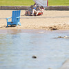 Record-Eagle/Keith King<br /> Jen and Tom Graham, of Illinois, take advantage of the warm temperatures as they relax and read on the beach at Clinch Park on West Grand Traverse Bay in Traverse City.