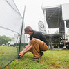 Record-Eagle/Keith King<br /> Kyle Huggett, team leader with SEEDS, puts up fencing as preparations are made for the 6th annual Traverse City Wine and Art Festival at the Village at Grand Traverse Commons.