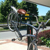 Record-Eagle/Marta Hepler Drahos<br /> Andy Worm's cruiser hangs from the Fixit public bike repair stand outside the Traverse City Visitors Center.