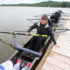 Record-Eagle/Keith King<br /> Sarah Donovan, a member of Recovery on Water (ROW), for women surviving breast cancer, along with other ROW members, sits in a rowing shell and pushes off a dock at Fountain Point Resort prior to rowing on Lake Leelanau with instruction from members of the University of Michigan men's rowing team during the ROW Blue rowing camp hosted by Fountain Point Resort and the Lake Leelanau Rowing Club. The University of Michigan men's rowing team recently won its seventh consecutive American Collegiate Rowing Association national championship.