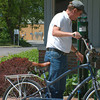 Record-Eagle/Marta Hepler Drahos<br /> Traverse City summer resident Andy Worm stops to investigate the Fixit public bike repair stand outside the Traverse City Visitors Bureau.