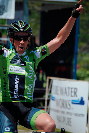 Record-Eagle/James Cook<br /> Richland's Chris Gottwald crosses the finish line in Sunday's Cherry-Roubaix road race in Cedar.