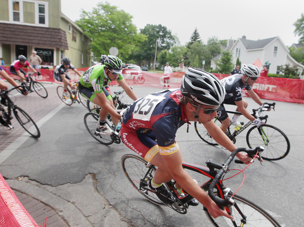 Record-Eagle/Keith King<br /> Racers turn from South Union Street onto West Ninth Street Saturday, June 15, 2013 during the Cherry-Roubaix Old Town Criterium Men Cat 3 race in Traverse City.