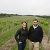 Record-Eagle/Keith King<br /> Taylor Simpson, left, Good Harbor Vineyards sales, distribution and marketing manager, and Sam Simpson, Good Harbor Vineyards winemaker and vineyard manager, stand Thursday, June 13, 2013 near Marechal Foch grape vines in Centerville Township.
