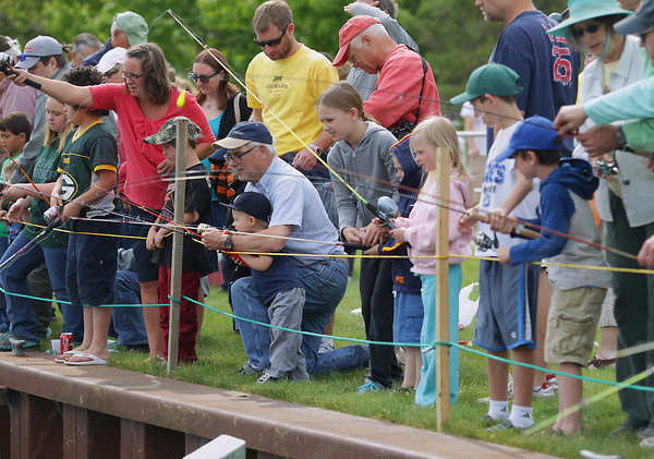 Record-Eagle/Keith King<br /> Fishing takes place Saturday, June 15, 2013 during the annual Kids' Free Fishing Day at the Northwestern Michigan College Great Lakes Campus.