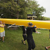 Record-Eagle/Keith King<br /> Ian McGraw, left, from the University of Michigan rowing team, and Sarah Donovan, of Chicago, Ill., along with others, carry an eight-person rowing shell toward Lake Leelanau Saturday, June 15, 2013 during the Recovery on Water (ROW) Blue rowing camp at Fountain Point on Lake Leelanau. The camp allows survivors of breast cancer to row with coaches and team members from the University of Michigan rowing team. McGraw is a Traverse City Central High School alumni.