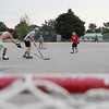 Record-Eagle/Keith King<br /> From left, Cam Givens, 16; Nico Saco, 17; Kyle Froese, 17; Thomas Lynch, 17; Lucas Little, 18; and Andrew Froese, 14, all of Traverse City, play hockey Monday in the parking lot of Traverse City Central High School.