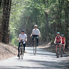 Record-Eagle/Jan-Michael Stump<br /> Margaret, left, and Colin Bohash, of Honor, ride their vintage bicycles near Dune Valley Road along the newly opened five-mile section of trail on Wednesday.