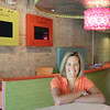Record-Eagle/Keith King<br /> Christina Burke, co-owner of Sugarkissed, stands Wednesday in the downtown Traverse City business that is scheduled to open on Monday.