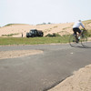 Record-Eagle/Keith King<br /> A bicyclist travels on the Sleeping Bear Heritage Trail past the Dune Climb on the Sleeping Bear Dunes National Lakeshore.