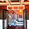 Record-Eagle/Dan Nielsen<br /> A man walks down a hallway during the Parade of Homes on Saturday. The event, which ended Sunday, featured 10 new homes in locations stretching from Leland to Williamsburg.