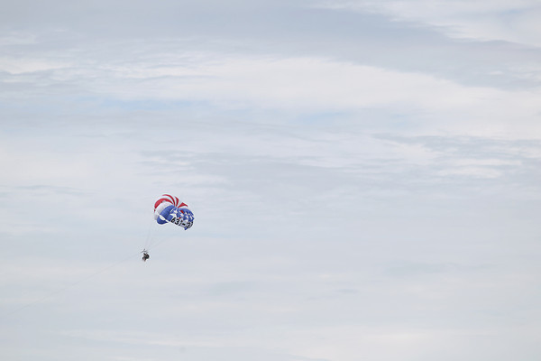 Record-Eagle/Keith King<br /> Parasailers travel Thursday, June 6, 2013 over East Grand Traverse Bay.