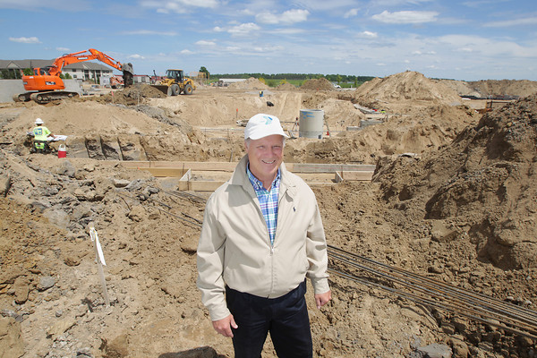 Record-Eagle/Keith King<br /> Tom Van Deinse, CEO of the Grand Traverse Bay YMCA, stands Thursday, June 6, 2013 near the location of where pools will be located at the new Grand Traverse Bay YMCA on Silver Lake Road in Traverse City.