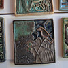 Record-Eagle/Keith King<br /> <br /> One of Leif Spšrck's early designs of a crow is displayed here on ceramic tile art Monday, May 21, 2012 in his shop, Spšrck Tileart, in Leland's Fishtown.