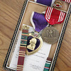 Record-Eagle/Keith King<br /> Ribbons and medals belonging to World War II veteran, Berdyll Hanrath, of Lake Township, lie Tuesday, June 4, 2013 on a table at his home.