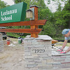 Record-Eagle/Keith King<br /> Robert Fritts, maintenance and project coordinator, places a section of flagstone onto mortar Tuesday, June 4, 2013 as he builds a new sign, which was designed by Howard Vogel, building and design consultant, and Fritts, for the entrance to the Leelanau School in Glen Arbor.