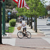 Record-Eagle/Keith King<br /> A bicyclist turns Friday, May 31, 2013 from Union Street onto State Street in downtown Traverse City. The 19th annual TART Trails' Smart Commute Week is scheduled for June 3-7 with a variety of events that can be found on the TART Trails website under 'Events.' The third annual Recycle-A-Bicycle Bike Swap is scheduled for Saturday, June 1, 2013 from 9:00 a.m. until 2:00 p.m. at the Old Town parking garage.
