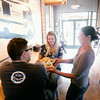 Record-Eagle/Keith King<br /> Lance Hill, from left, and Chelsea Hill, both of Traverse City, are served food by Rebecca Brown, co-owner, at Harvest in downtown Traverse City.
