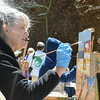 Record-Eagle/Allison Batdorff<br /> Sue Bowerman and Nan Frankland chat while Bowerman paints on a blustery day in Traverse City. Both paint with the Magic Thursday Artists and will be featured in a show at the City Opera House this July.