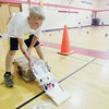 """Record-Eagle/Keith King<br /> Anderson Farmer, 8, of Traverse City, tests a pulley car he assembled at Willow Hill Elementary School during Camp Invention, organized by the National Inventors Hall of Fame, which also took place locally at Cherry Knoll Elementary School. For more information visit  <a href=""""http://www.campinvention.org"""">http://www.campinvention.org</a>."""