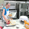 Record-Eagle/Nathan Payne<br /> Deb Nickerson, owner of Betsie Bay Bread, spent the afternoon Wednesday baking bread in the Grow Benzie Incubator Kitchen. Nickerson started working in the kitchen shortly after it opened in June 2013.