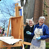 Record-Eagle/Allison Batdorff<br /> From left; Sue Bowerman, Ruth Kitchen and Nan Frankland advise on Kitchen's plein air painting in downtown Traverse City. The Magic Thursday Artists get together every week, rain, snow or shine.
