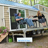 """Record-Eagle/Allison Batdorff<br /> John Russell and Debbie Hanson toast their """"Ritz on Wheels,"""" a 200-square-foot home parked in Kalkaska."""