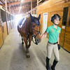 Record-Eagle/Keith King<br /> Mackenzie Snider, 13, of Maple City, prepares to ride Varina, a Dutch Warmblood, at Northern Pines Farm, in Cleveland Township, as she prepares for the Horse Shows by the Bay Equestrian Festival.