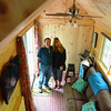 Record-Eagle/Allison Batdorff<br /> John Russell and Debbie Hanson celebrated one month of tiny house living last week. The couple minimized their possessions and built a 200-square foot house.