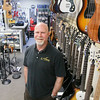 Record-Eagle/Keith King<br /> Gene Hansen, owner, stands in Traverse City Guitar Company in downtown Traverse City.