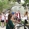 Record-Eagle/Keith King<br /> The Accidentals, comprised of Katie Larson, left, and Savannah Buist, perform Tuesday, June 25, 2013 at the redesigned Clinch Park prior to the start of the grand opening ceremony.