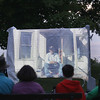 Record-Eagle/Keith King<br /> Attendees watch a movie at dusk Thursday, June 20, 2013 during Outdoor Movie Night presented by the Grand Traverse Lighthouse Museum in Leelanau Township. Movies are scheduled to be shown on select Thursdays and Saturdays through the summer until August 31. For more information call 231-386-7195.