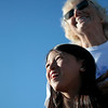 Record-Eagle/Jan-Michael Stump<br /> Leilani Sigsbey, 9, left, and her grandmother, Marcia Conklin, watch their butterflies fly away after releasing them in memory of Leilani's mother -- Marcia's daughter -- Marilyn Conklin-Sigsbey, as they and more than 40 other people gather at the Greilickville Harbor Park on Monday evening for a butterfly release to remember lost loved ones. Participants released three dozen butterflies.