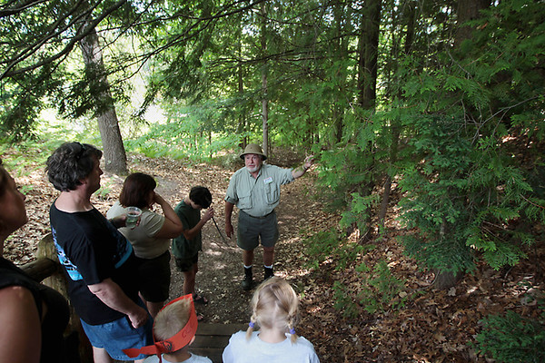 Record-Eagle/Keith King<br /> Tom Jenkins, Boardman River Nature Center environmental educator and retired Michigan Department of Natural Resources employee, guides a nature hike on the Sabin Trail during the Boardman River Nature Fest at the Boardman River Nature Center.