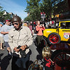 Record-Eagle/Keith King<br /> Alan Travis, of Phoenix, Ariz., talks with others near his 1907 Renault in Traverse City on Saturday, before the start of the 2012 Great Race. The event, approximately 2,283 miles over the span of nine days, takes racers north to Sault Ste. Marie, then east through Canada to New York, then west through Pennsylvania and Ohio to the finish line in Dearborn, This year's race is sponsored by Traverse City based Hagerty Insurance.