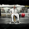 Record-Eagle/Jan-Michael Stump<br /> Bill Bustance sits in the ring of his Trigger Boxing gym in Traverse City, which could lose funding for its at-risk youth boxing program under county board cuts.