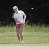 Record-Eagle/Keith King<br /> Katie Burnett watches a chip shot during the second round of the Michigan Women's Open.