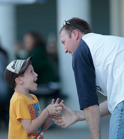 Record-Eagle/Jan-Michael Stump<br /> Logan Northrop, 6, reacts as his father Greg Northrop hands him a foul ball.