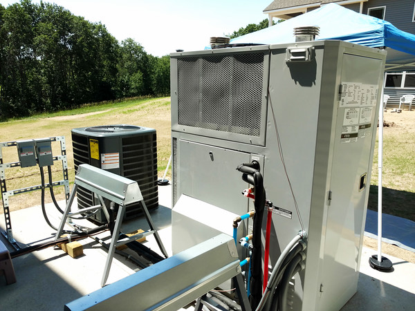 Record-Eagle/Dan Nielsen<br /> The natural-gas-fueled triple-purpose unit at right is the first such device in Michigan to be connected to a residence.
