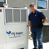 Record-Eagle/Dan Nielsen<br /> Robert Fegan Jr., principal market technical consultant for DTE Energy, said this natural-gas-fuled PowerAire unit by M-Trigen heats and cools a new house west of Traverse City, and also can produce enough elecricity to fully power the home.