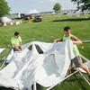 Record-Eagle/Keith King<br /> Nicholas Moon, left, and Cade Hunt, both with American Rental, set up tents at the Open Space as preparations take place for the National Cherry Festival which is scheduled to begin July 5.