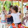 Record-Eagle/Keith King<br /> Sienna Smith, 5, of Arizona, waves to her parents while riding a carousel at the Arnold Amusements Midway in Traverse City.