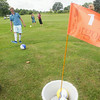 Record-Eagle/Keith King<br /> Matt Grost, of Traverse City, kicks a ball during a FootGolf demonstration at Elmbrook Golf Course as part of events celebrating the golf course's 50th anniversary.