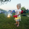 Record-Eagle/Keith King<br /> Kelty Rindlisbacher, 2, of Perry, hold a sparkler at West End Beach prior to the start of the Fourth of July fireworks show on West Grand Traverse Bay in Traverse City.