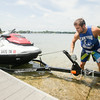 Record-Eagle/Keith King<br /> Patrick Fancy, co-owner of Fancy PWC Watercraft Rentals, uses a winch to pull a jet ski onto a trailer at Silver Lake after a customer rented the jet ski.