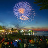 Record-Eagle/Keith King<br /> Spectators look on from Clinch Park beach as the Fourth of July fireworks show takes place on West Grand Traverse Bay in Traverse City.