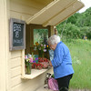 Record-Eagle/Marta Hepler Drahos<br /> Jean Weinheimer selects a quart of strawberries at Sonny's farm stand in Cedar.