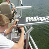 Record-Eagle/Keith King<br /> Austin Schaub, 14, of Traverse City, sets up a LilliPad Diving Board as his father, Corey Schaub, operations manager at LilliPad, and designer and inventor, with assistance from his family, of the LilliPad Diving Board, operates his boat on Arbutus Lake in East Bay Township.