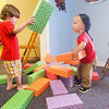 Record-Eagle/Keith King<br /> Grayson Wirtjes, left, 3, and Colten Beaver, 2, play at Bright Blooms KinderPlay at Logan's Landing in Traverse City.
