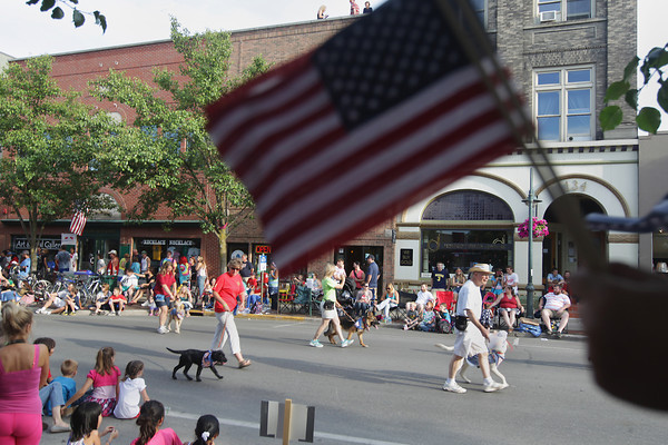 Record-Eagle/Keith King<br /> Leader Dogs for the Blind travels on Front Street Thursday, July 4, 2013 in the Junior Royale Parade during the 87th National Cherry Festival in Traverse City.